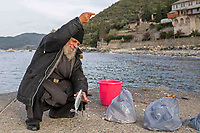 Mount Athos - The Holy Mountain.<br /> A monk fishes outside of Xenophontos monastery.