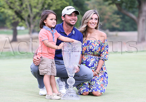 August 30, 2015: Jason Day, his wife Ellie, and son Dash pose with the Barclays Trophy presented today after shooting 19 under par to win The Barclays at Plainfield Country Club in Edison, NJ.