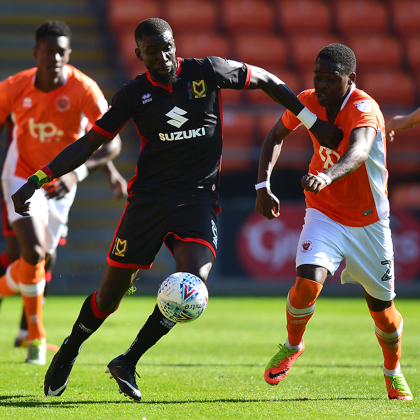 Milton Keynes Dons' Ousseynou Cisse battles with Blackpool's Bright Osayi-Samuel<br /> <br /> Photographer Richard Martin-Roberts/CameraSport<br /> <br /> The EFL Sky Bet League One - Blackpool v Milton Keynes Dons - Saturday August 12th 2017 - Bloomfield Road - Blackpool<br /> <br /> World Copyright &copy; 2017 CameraSport. All rights reserved. 43 Linden Ave. Countesthorpe. Leicester. England. LE8 5PG - Tel: +44 (0) 116 277 4147 - admin@camerasport.com - www.camerasport.com