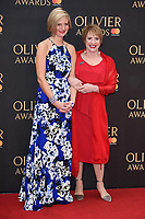 Marianne Elliott and Patti LuPone<br /> arriving for the Olivier Awards 2018 at the Royal Albert Hall, London<br /> <br /> ©Ash Knotek  D3392  08/04/2018