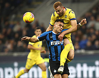 Calcio, Serie A: Inter Milano - Hellas Verona, Giuseppe Meazza stadium, November 9, 2019.<br /> Hellas Verona's Amir Kadri Rrahmani (r) in action with Inter's Lautaro Martinez (l) during the Italian Serie A football match between Inter and Hellas Verona at Giuseppe Meazza (San Siro) stadium, on November 9, 2019.<br /> UPDATE IMAGES PRESS/Isabella Bonotto