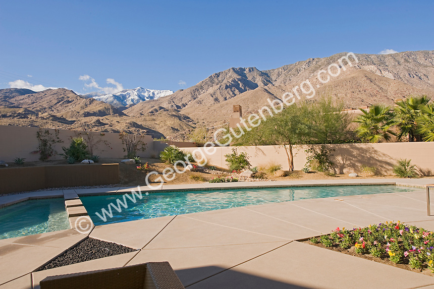 Modern pool design in backyard over looking mountains