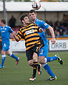 Alloa's Kevin Cawley holds off Queen of the South's Mark Durnam.