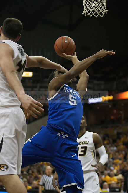 Kentucky Wildcats guard Andrew Harrison (5) lays the ball while a hand is in his face from Missouri Tigers forward Ryan Rosburg (44) during the game between the University of Kentucky men's basketball team and University of Missouri in Columbia, Mo.,on Saturday, February 1, 2014. Kentucky defeated Missouri 84-79. Photo by Michael Reaves | Staff