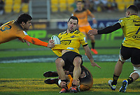 James Marshall is tackled during the Super Rugby match between the Hurricanes and Jaguares at Westpac Stadium in Wellington, New Zealand on Friday, 17 May 2019. Photo: Dave Lintott / lintottphoto.co.nz