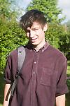 Model released head and shoulders portrait of teenage boy in rural area, UK