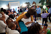First Lady Michelle Obama hugs a young girl in the the Diplomatic Reception Room of the White House, November 29, 2010. The First Lady welcomed children who participated in the President's Active Lifestyle Award. .Mandatory Credit: Samantha Appleton - White House via CNP