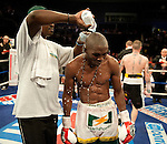 GLASGOW, SCOTLAND - MARCH 10: Ricky Burns of Scotland defeats  Paulus Moses of Namibia to retain the WBO world lightweight title fight at the Braehead Arena on March 10, 2012 in Glasgow, Scotland. (Photo by Rob Casey/Getty Images)