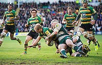 Mike Haywood of Northampton Saints is tackled to ground by Dan Cole of Leicester Tigers. Aviva Premiership match, between Northampton Saints and Leicester Tigers on April 16, 2016 at Franklin's Gardens in Northampton, England. Photo by: Patrick Khachfe / JMP