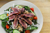 Raspberry red wine marinaded duck over garden salad from Black Bear Bistro in Warrenton