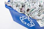 USA, Illinois, Metamora, Recycling bin full of US money