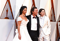 Camila Alves, from left, Matthew McConaughey, and Timothee Chalamet arrive at the Oscars on Sunday, March 4, 2018, at the Dolby Theatre in Los Angeles. (Photo by Jordan Strauss/Invision/AP)