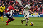 Atletico de Madrid's Rodrigo Hernandez and Real Madrid's Karim Benzema during La Liga match between Atletico de Madrid and Real Madrid at Wanda Metropolitano Stadium in Madrid, Spain. February 09, 2019. (ALTERPHOTOS/A. Perez Meca)