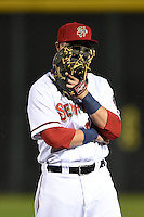 Harrisburg Senators first baseman Matt Skole (10) covers his face laughing after a play during a game against the New Britain Rock Cats on April 28, 2014 at Metro Bank Park in Harrisburg, Pennsylvania.  Harrisburg defeated New Britain 9-0.  (Mike Janes/Four Seam Images)