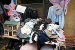 Old clothes and jumble outside charity shop, Walcot, Bath, England