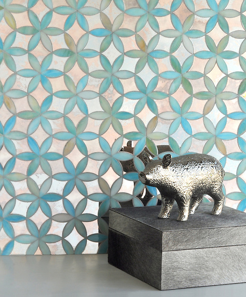 Fiona, a waterjet mosaic shown in Aquamarine jewel glass and Dawn mirror, is part of the Silk Road collection by Sara Baldwin for New Ravenna.