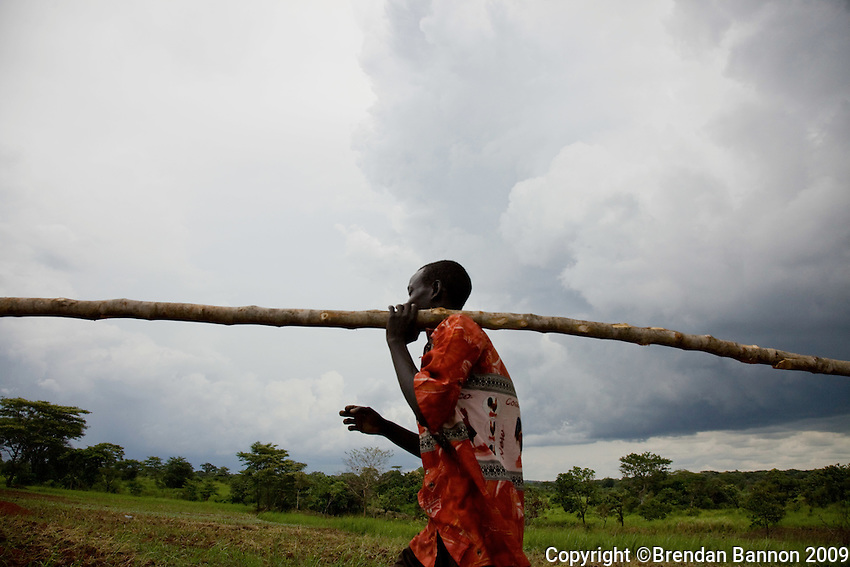 A man constructing a shelter for his family in Nyori refugee camp, South Sudan..He fled Congo when the LRA attacked his village..