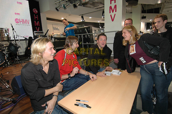 DIRTY VEGAS.At HMV Oxford Circus, 150 Oxford Street, London, W1 playing live set and signing copies of their new album 'One'.October 19th, 2004.music, band, sitting, fans, signing autographs.www.capitalpictures.com.sales@capitalpictures.com.©Capital Pictures