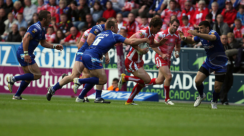 30.05.2011. Engage Super League Rugby. Wigan Warriors versus Hull Kingston Rovers at the DW Stadium/ Sean O'Loughlin breaks through a tackle and is chased by Blake Green
