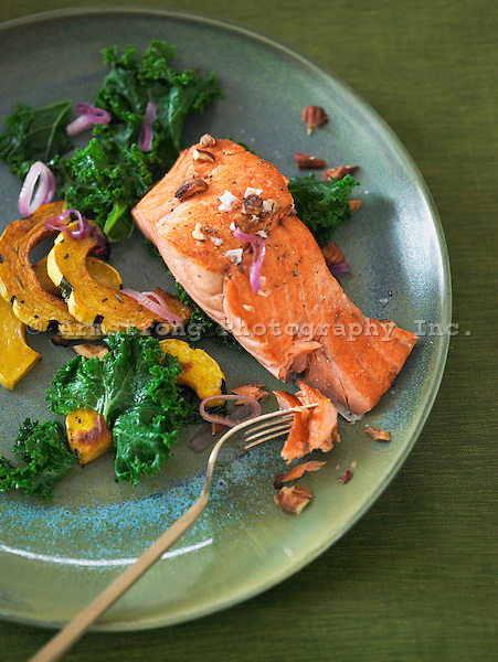 Fillet of salmon topped with pecans and red onions, served with steamed kale and roasted delicata squash