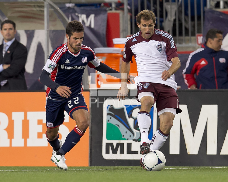 Colorado Rapids midfielder Brian Mullan (11) attempts to control the ball as New England Revolution midfielder Benny Feilhaber (22) closes. In a Major League Soccer (MLS) match, the New England Revolution defeated the Colorado Rapids, 2-1, at Gillette Stadium on May 2, 2012.