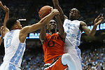 20 February 2016: Miami's Ja'Quan Newton (center) is defended by North Carolina's Nate Britt (left) and Theo Pinson (1). The University of North Carolina Tar Heels hosted the University of Miami Hurricanes at the Dean E. Smith Center in Chapel Hill, North Carolina in a 2015-16 NCAA Division I Men's Basketball game. UNC won the game 96-71.