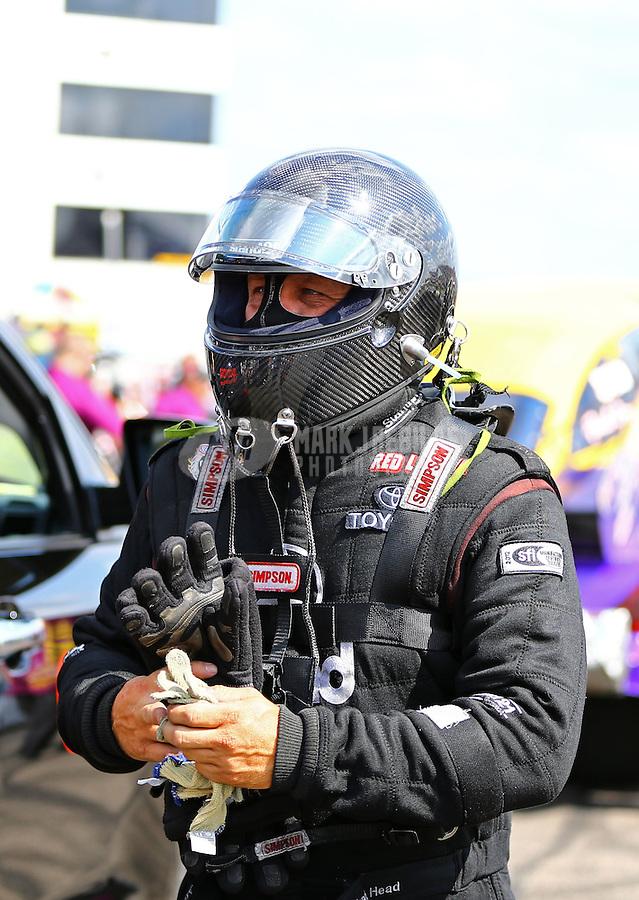 Aug 15, 2014; Brainerd, MN, USA; NHRA funny car driver Chad Head during qualifying for the Lucas Oil Nationals at Brainerd International Raceway. Mandatory Credit: Mark J. Rebilas-
