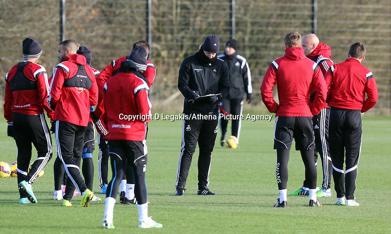 Pictured: Manager Garry Monk (C) Wednesday 10 December 2014<br /> Re: Swansea City FC training at Fairwood Training Ground, south Wales, UK