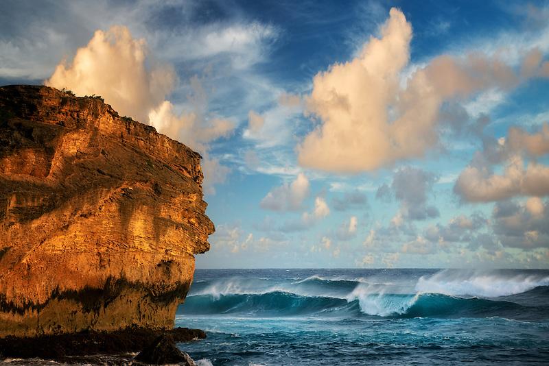 Sunset with waves. Shipwreck Beach; Kauai; Hawaii