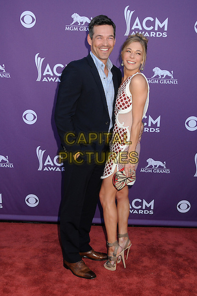 Eddie Cibrian, LeAnn Rimes.47th Annual Academy of Country Music Awards held at the MGM Grand, Las Vegas, Nevada, USA..April 1st, 2012.full length black suit blue shirt white red maroon burgundy one shoulder sheer dress smiling couple side polka dot print pattern ACM CMA.CAP/ADM/BP.©Byron Purvis/AdMedia/Capital Pictures.