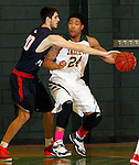 JANUARY 24, 2015 -- Stevan Radakovic #40 of CSU-Pueblo reaches on Yoshio Allen #24 of Black Hills State during their Rocky Mountain Athletic Conference men's basketball game at the Donald E. Young Center in Spearfish, S.D. Saturday. (Photo by Dick Carlson/Inertia)