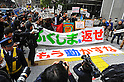 Tokyo, Japan - March 11: People gathered at a demonstration against nuclear power plants in front of Tokyo Electric Power Company at Chiyoda, Tokyo, Japan on March 11, 2012. As this day was one year anniversary of Great East Japan Earthquake and Tsunami, there were many demonstrations held in the city.