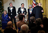Actress Barbara Cook (L), singer Neil Diamond (2L), musician Yo-Yo Ma (3L), musician Sonny Rollins (3R) get up as United States President Barack Obama (2R) hugs actress Meryl Streep during a Kennedy Center Honors reception in the East Room of the White House, Sunday, December 4, 2011 in Washington, DC.  For their accomplishments and contributions to the arts actress Meryl Streep, singer Neil Diamond, actress Barbara Cook, musician Yo-Yo Ma, and musician Sonny Rollins where etched recognized as this year's recipients of the Kennedy Center Honors..Credit: Brendan Smialowski / Pool via CNP