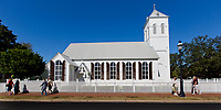 A tour group walks by Old Christ Church, one of Florida's oldest surviving churches, in Historic Pensacola Village. <br /> <br /> <br /> COLIN HACKLEY PHOTO