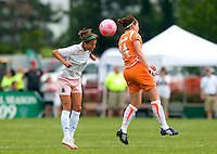 St. Louis Athletica forward Angie Woznuk (11) goes up for a ball against Sky Blue FC midfielder Collette McCallum (14) during a WPS match at Anheuser-Busch Soccer Park, in St. Louis, MO, June 7 2009.  Athletica won the match 1-0.