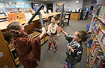 From left, Anne Jones, Shaylee Erickson, both 6, and June Jones, 4, play in the Jedi Training Academy during the Star Wars Day celebration at the Carson City Library in Carson City, Nev. on Wednesday, May 4, 2016.<br />