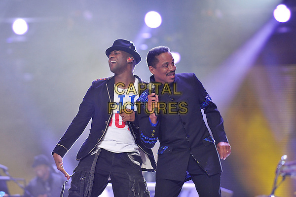 Oritse Williams and Marlon Jackson.Michael Forever Tribute Concert at The Millenium Stadium, Cardiff, Wales, UK 8th October 2011.performing live in on stage .CAP/MAR.© Martin Harris/Capital Pictures.