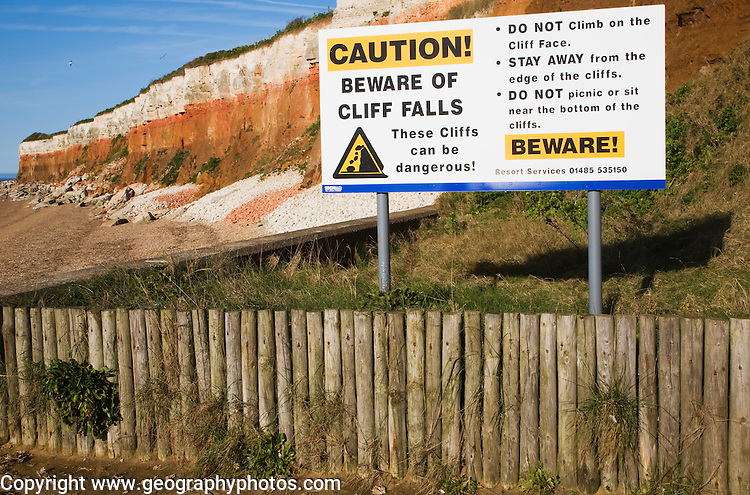 Caution beware of cliff falls sign at Hunstanton, Norfolk, England