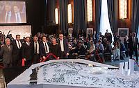 Da sinistra, il presidente del Coni Lazio Riccardo Viola, l'amministratore delegato della Roma Italo Zanzi, l'amministratore delegato di Stadio della Roma Mark Pannes, il presidente della Roma James Pallotta, il costruttore Luca Parnasi e gli architetti Daniel Libeskind ed Andreas Kipar posano davanti al progetto del nuovo stadio della Roma in occasione della conferenza stampa sulla rigenerazione urbana dell'area di Tor di Valle, a Roma, 15 giugno 2015.<br /> From left, CONI Lazio's president Riccardo Viola, AS Roma's CEO Italo Zanzi, Stadio della Roma's CEO Mark Pannes, AS Roma's President James Pallotta, constructor Luca Parnasi and architects Daniel Libeskind and Andreas Kipar pose past the project of the AS Roma's new stadium prior to the start of a press conference on the urban regeneration of Tor di Valle, the area chosen for the construction of the stadium, in Rome, 15 June 2015.<br /> UPDATE IMAGES PRESS/Riccardo De Luca