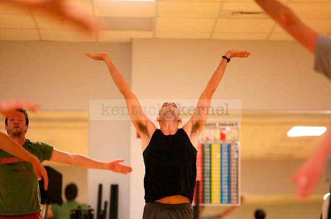 Kinesiology senior Patrick Sims teaches the Yogamuscle class on Wednesday at 7 p.m. at the Johnson Center..Photo by Zach Brake | Staff