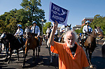 Protesters voice their opposition to the wars in Afghanistan and Iraq as Park Police on horseback try to clear the sidewalk in front of the White House on Oct. 5, 2009.