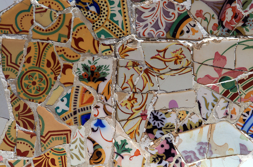 Detail of broken tile tesserae used on benches at Gaudi-designed Park Guell in Barcelona, Spain.