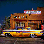 Yellow classic car outside motel in USA