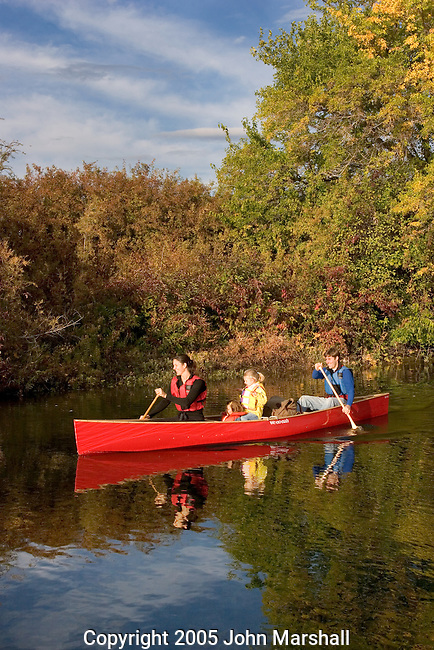 The Grant and Carrie Scull familly paddling a Wenonah Escape at Wenatchee Confluence State Park, Washington.