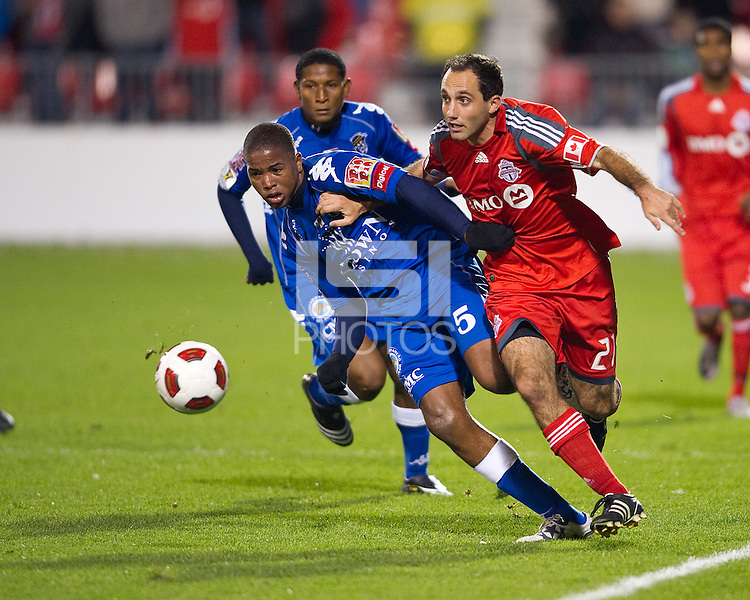 19 October 2010: Toronto FC midfielder Nick LaBrocca #21 and Arabe Unido Paul Roderick #5 in action during a CONCACAF game between Arabe Unido and Toronto FC at BMO Field in Toronto..