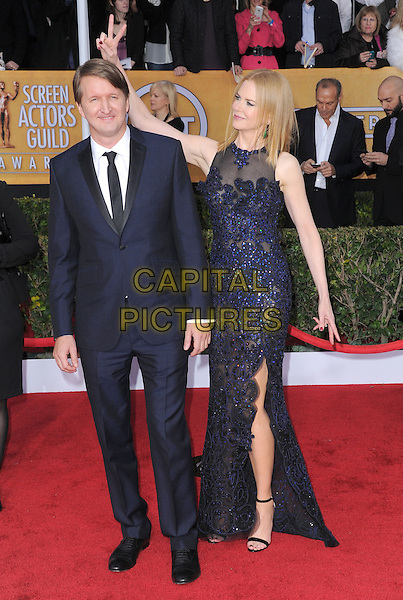 Tom Hooper & Nicole Kidman Urban (wearing Vivienne Westwood).Arrivals at the 19th Annual Screen Actors Guild Awards at the Shrine Auditorium in Los Angeles, California, USA..27th January 2013.SAG SAGs full length black suit blue lace dress hand v peace sign bunny ears funny slit split sleeveless.CAP/DVS.©DVS/Capital Pictures.