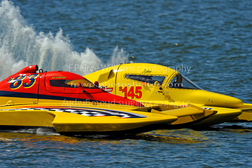 """Dutch Squires, S-83 """"Mega Bucks"""" and John Shaw, S-145 """"Willard Wilson's Lil' Lectron"""" race for the lead. (2.5 Litre Stock hydroplane(s)"""