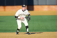 Wake Forest Demon Deacons shortstop Conor Keniry (14) on defense against the Towson Tigers at Wake Forest Baseball Park on February 15, 2014 in Winston-Salem, North Carolina.  (Brian Westerholt/Four Seam Images)