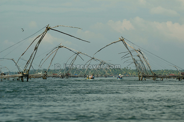 India, Kerala, Backwaters. Long row of chinese style fishing nets in the Backwaters between Kollam to Allepey. No releases available.