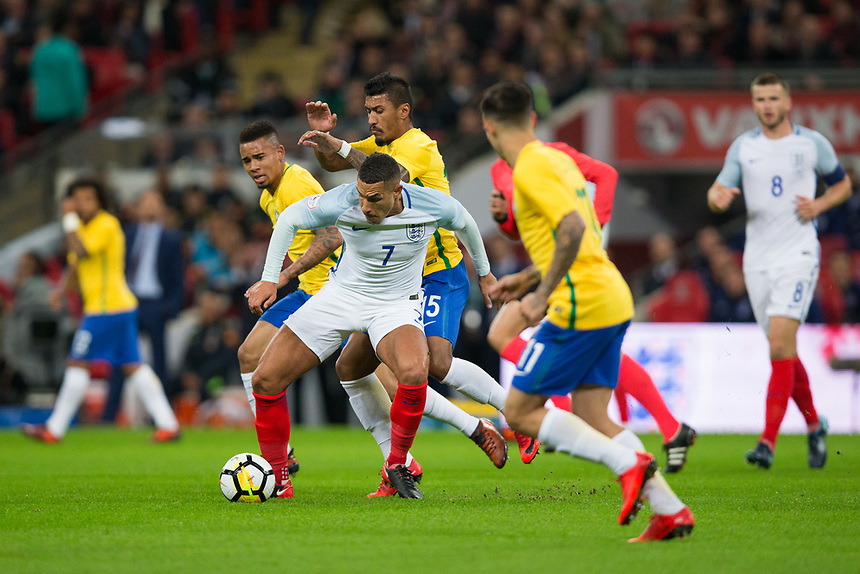 England's Jake Livermore holds off the challenge from Brazil&rsquo;s Paulinho <br /> <br /> Photographer Craig Mercer/CameraSport<br /> <br /> The Bobby Moore Fund International - England v Brazil - Tuesday 14th November 2017 Wembley Stadium - London  <br /> <br /> World Copyright &copy; 2017 CameraSport. All rights reserved. 43 Linden Ave. Countesthorpe. Leicester. England. LE8 5PG - Tel: +44 (0) 116 277 4147 - admin@camerasport.com - www.camerasport.com